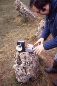 "Researcher Don Robins using a ""bat detector"" type ultrasound receiver inside the King's Men stone circle, Rollright"